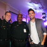 Indian River County Sheriff's Maj. Eric Flowers and Deputy Teddy Floyd greet Jake before the VIP reception/auction held at Vero Beach Country Club. CHRISTINA TASCON
