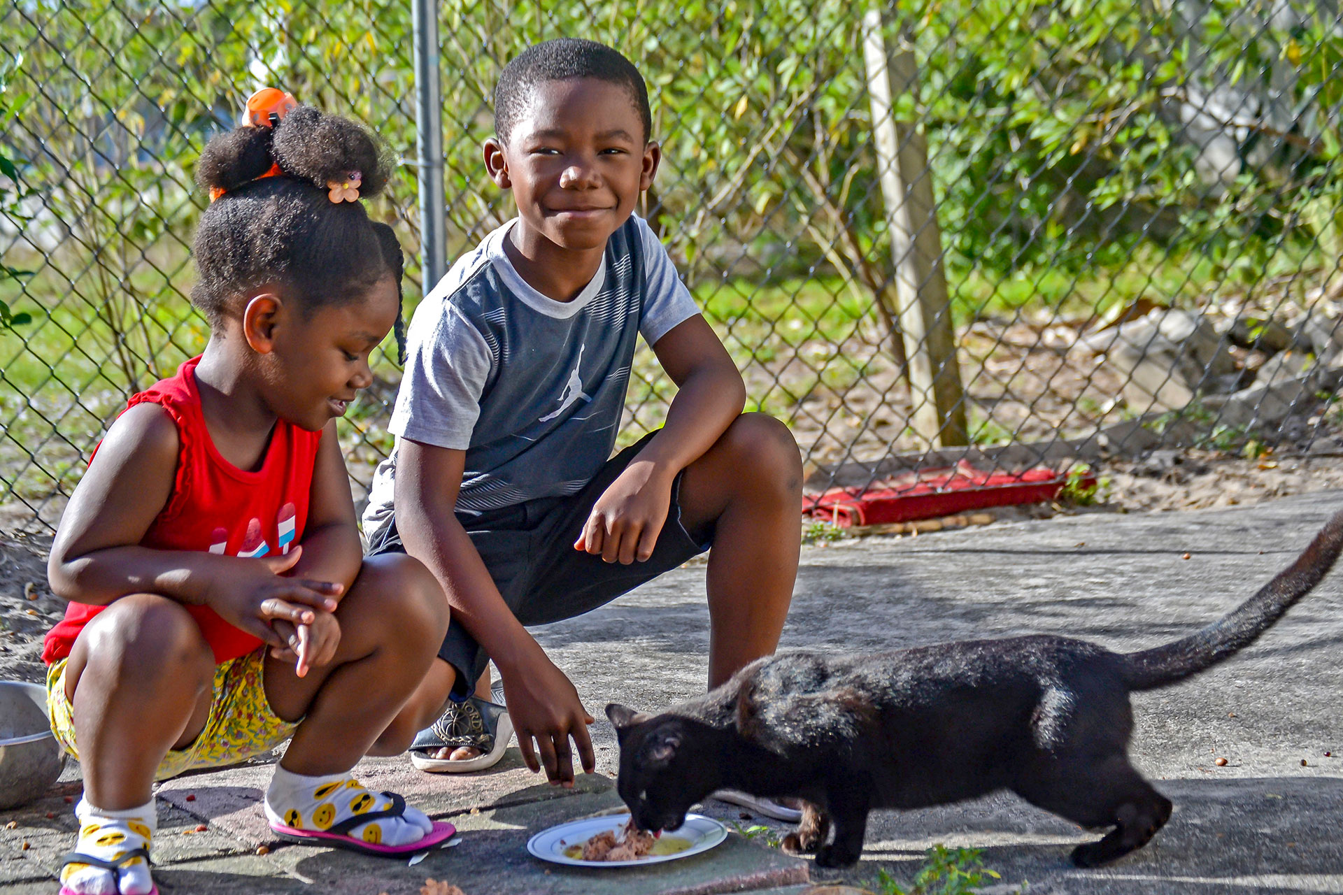 Neveah Edmond, 4, and Edson Edmond, 8, learn humane treatment of animals
