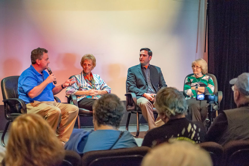 Indian River Magazine publisher, moderates a discussion