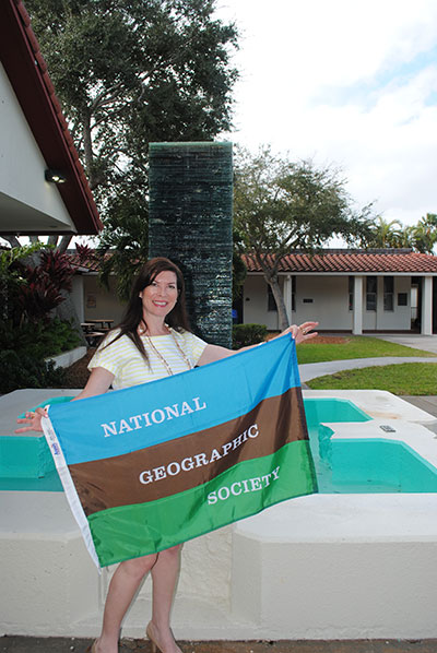 Monahan proudly displays her National Geographic Society banner.