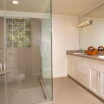 A guest bathroom, remodeled by a previous owner, is just one of the seven bathrooms in this home.