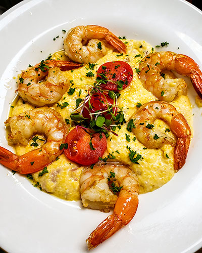 bowl of cheesy Georgia Stone Mountain grits with wild-caught Gulf Coast shrimp