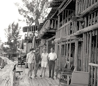 Guests walk along the deck of the Driftwood Inn