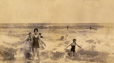 Children frolic in the surf on Vero Beach in the 1930s