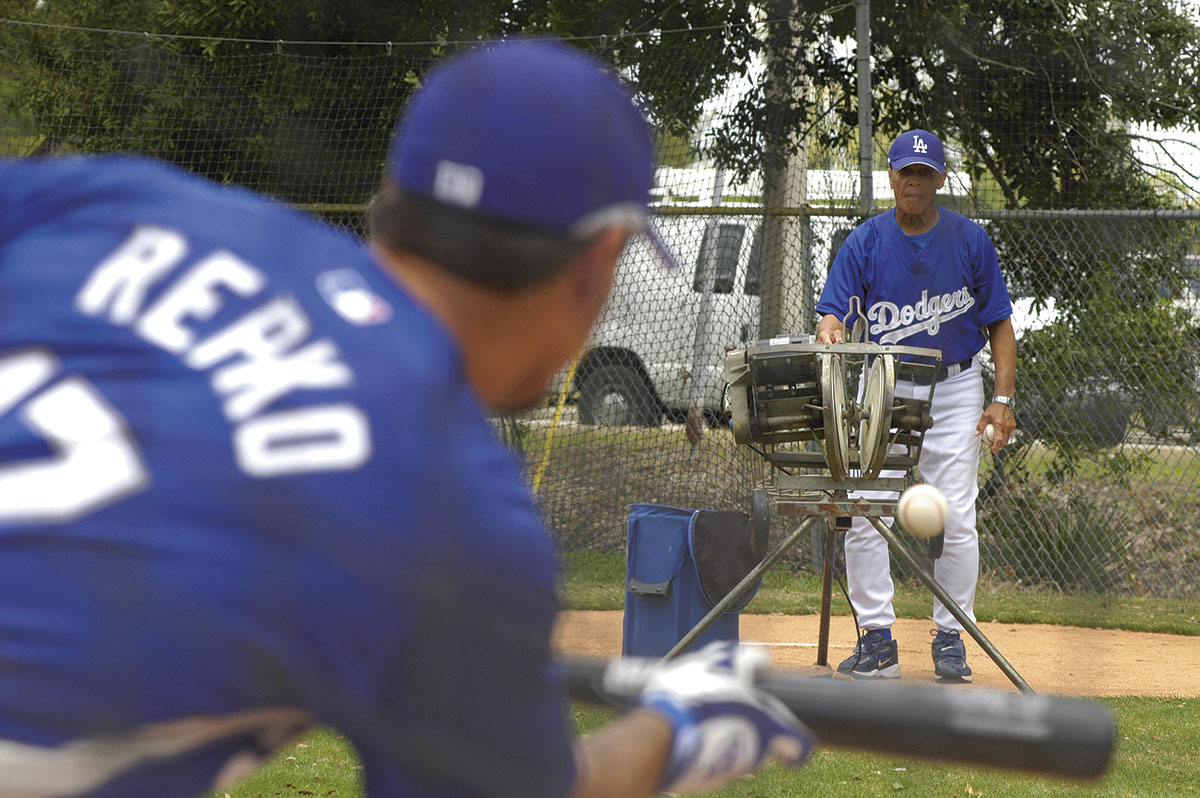 Maury Wills assists with bunting practice during spring training in 2007