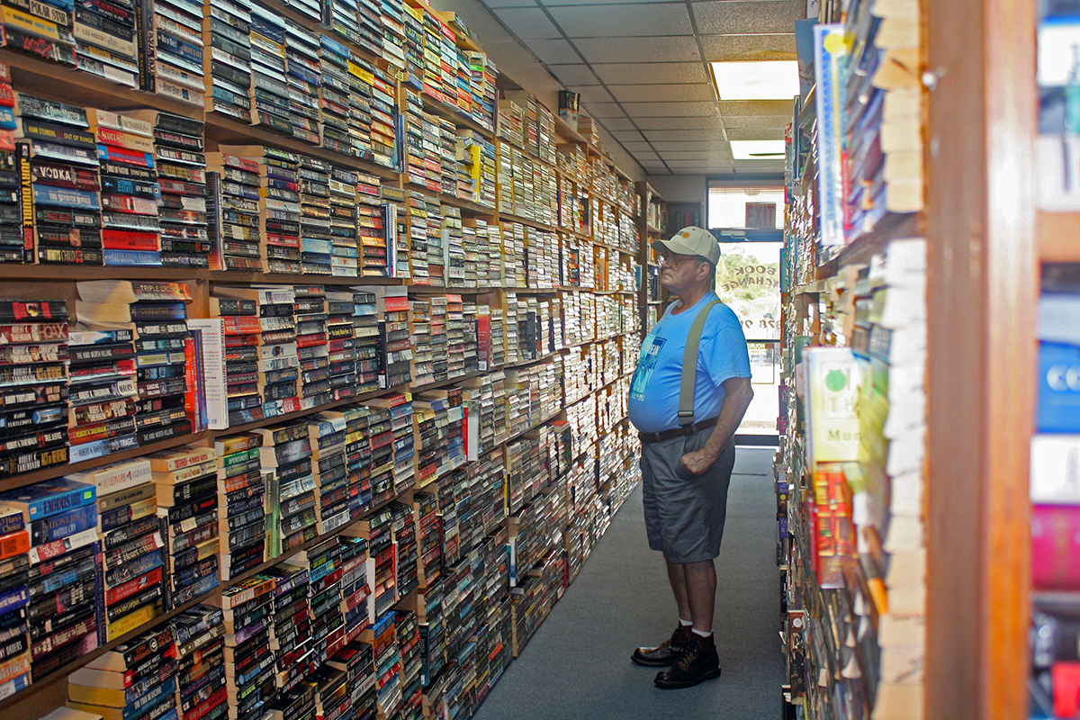 First-time customer John Hilkene peruses the varied used book selections