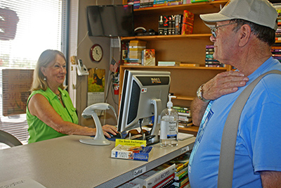 Owner Mary Loper rings up a sale