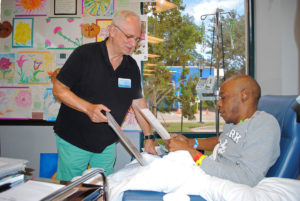 Artist Barry Shapiro helps patient Antonio Jenkins