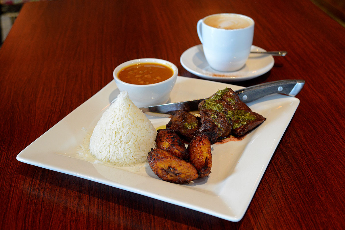 The juicy churasco with chimichurri sauce goes perfectly with platanos maduros (sweet fried plantains) and arroz con habichuelas (rice and beans).