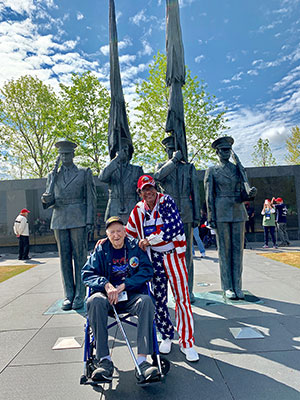 World War II veteran Richard Lewis of Port St. Lucie visits the WWII Memorial in Washington, D.C., with Singh