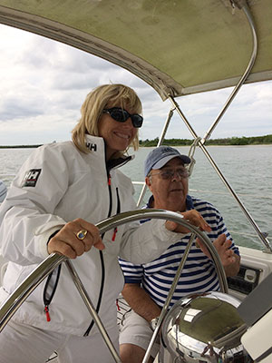 Rikki Eriksen sailing with her dad, Ron Grober. Grober died last year.