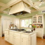With intricate crown molding, the spacious chef-ready kitchen is set up to cook for large parties.