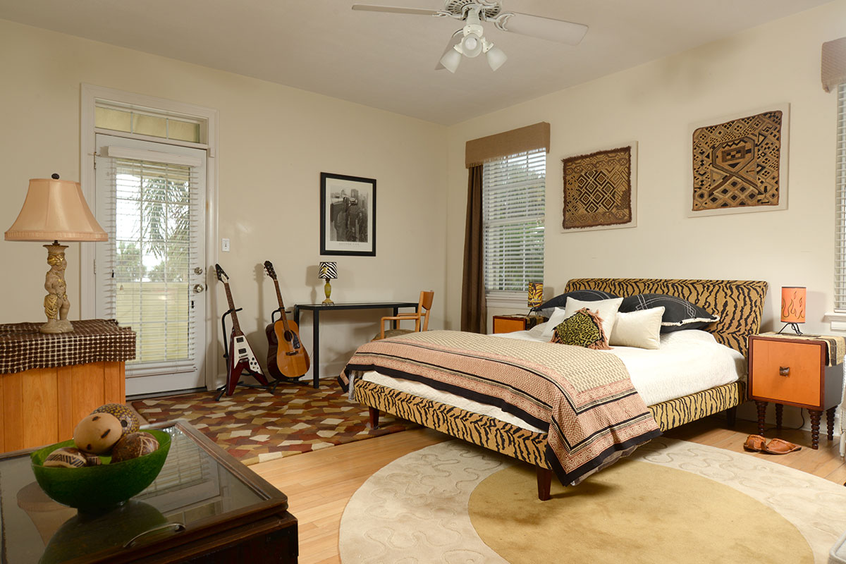 In the upstairs guest suite, two collectible African Kuba cloths made from raffia grass adorn the wall above the bed.