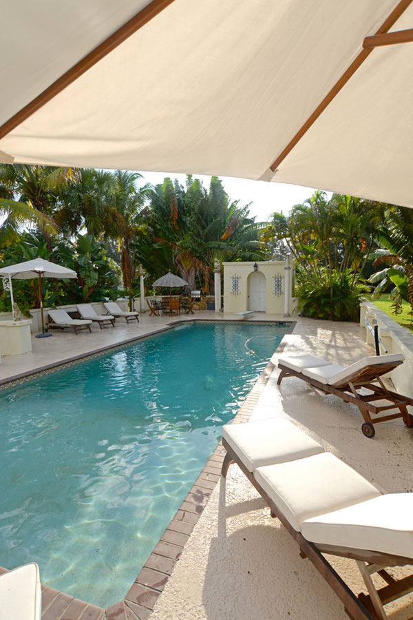 The pool area, featuring lush vegetation, a restored cabana and a barbecue grill, is perfect for gatherings.