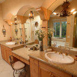 Refinished with Venetian plaster, the master bathroom features a spa tub, a shower and his-and-hers vanities.
