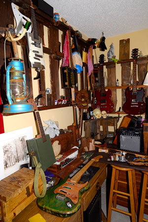 studio full of odds and ends and guitars