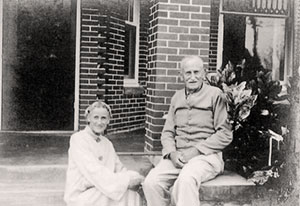 Ruth Hallstrom sits on the front porch with her father, Axel Hallstrom.