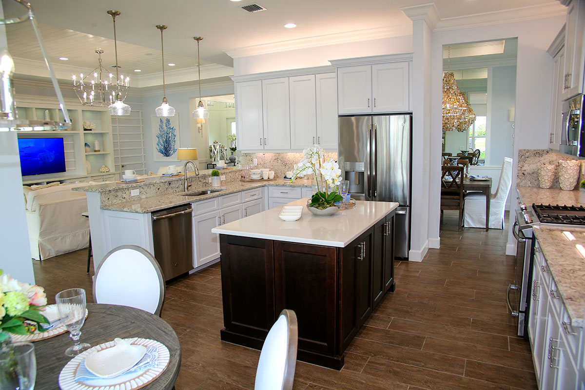 Breakfast nook, breakfast bar and an island in the Caroline model's kitchen