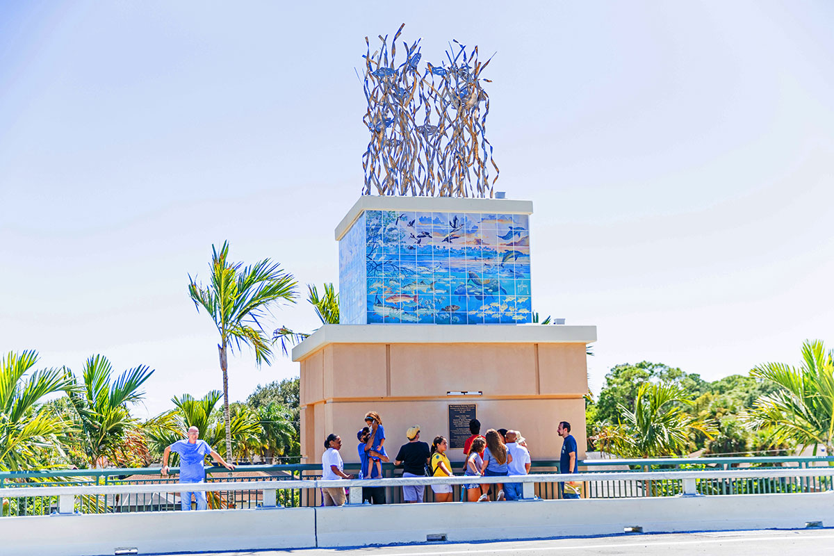 Guy Harvey scene of the Indian River Lagoon and the metal sculpture depicting seagrass