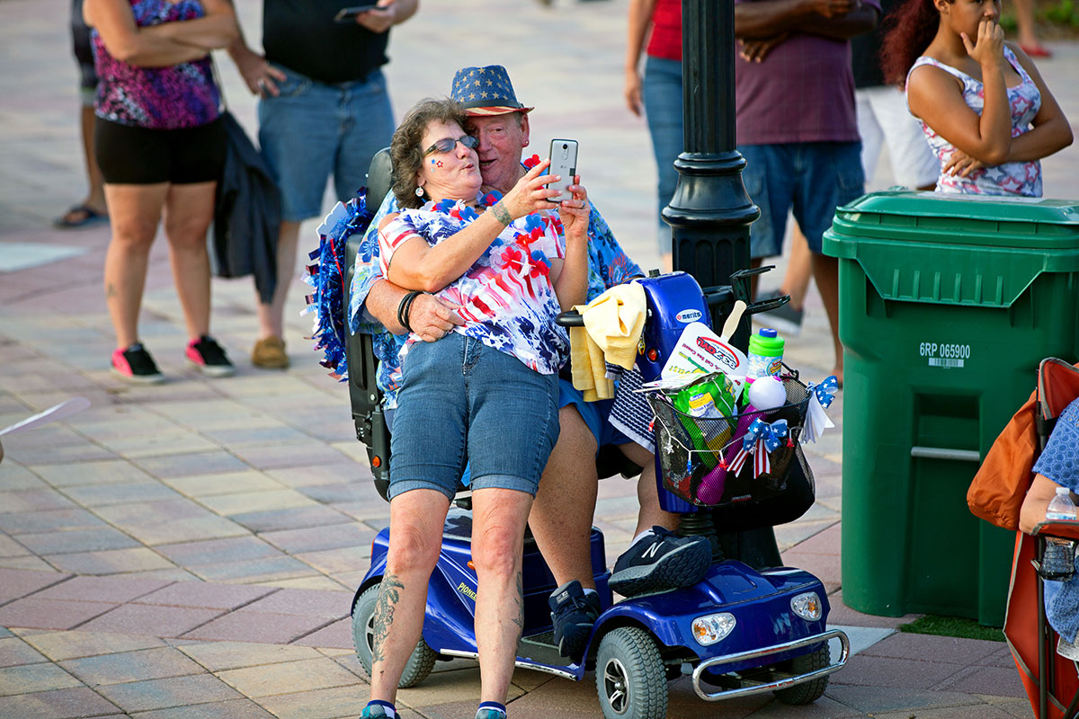 couple makes good use of a mobility scooter