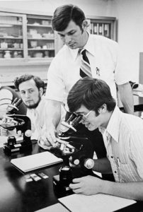 Dr. Massey works with biology students in 1978