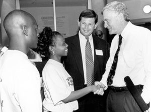 Florida Gov. Lawton Chiles, right, shakes hands with IRCC students during a tour of the new Science Center with President Ed Massey in 1994