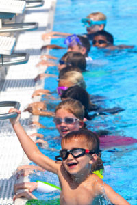 Children participate in an Aqua summer camp at the Anne Wilder Aquatic Complex