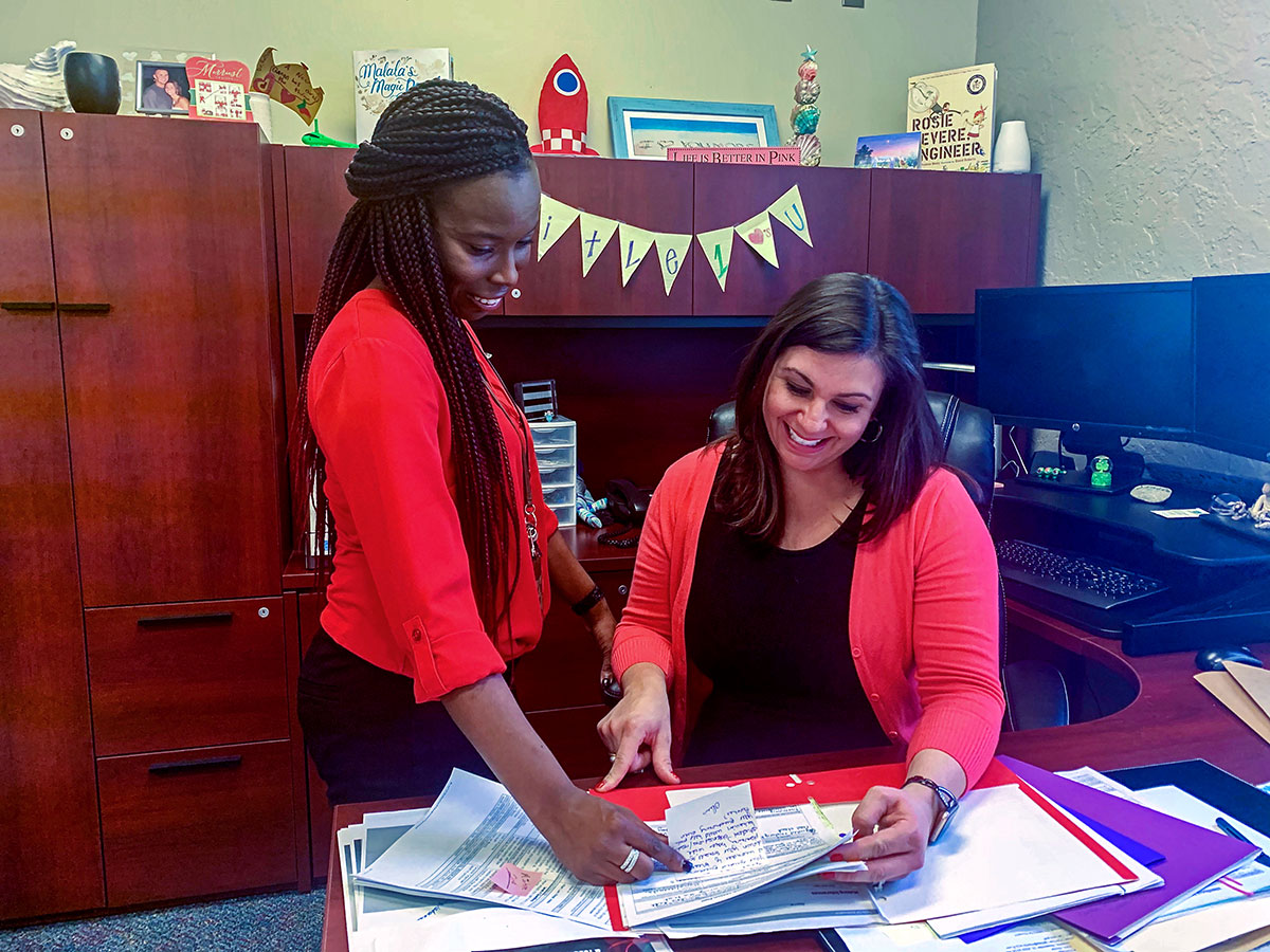 LaShawnda McNair and Dr. Nicole Rathnaw, principal of J.D. Parker Elementary
