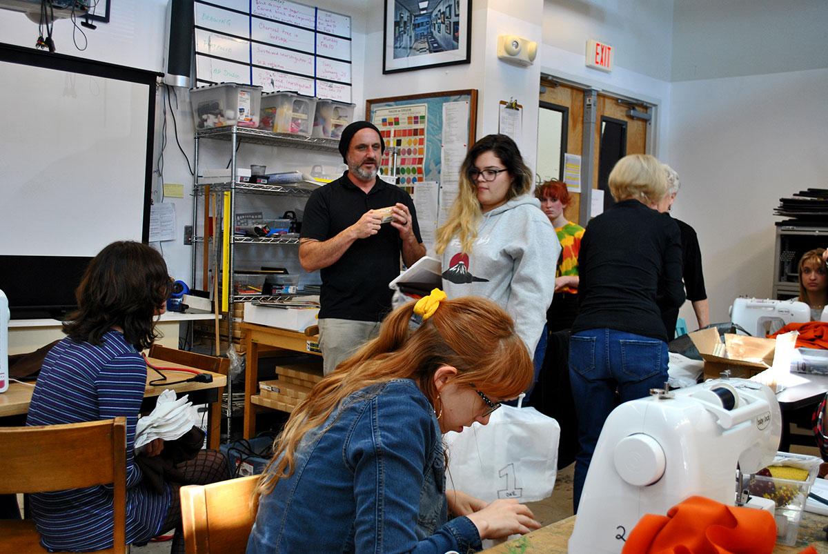 Michael Naffziger organizes a sewing class