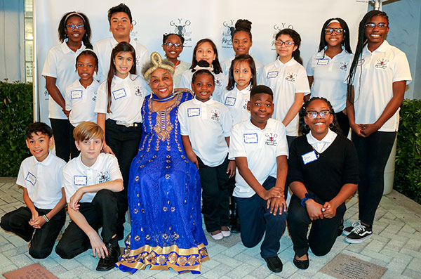 Dr. Crystal Bujol with Gifford Youth Orchestra members