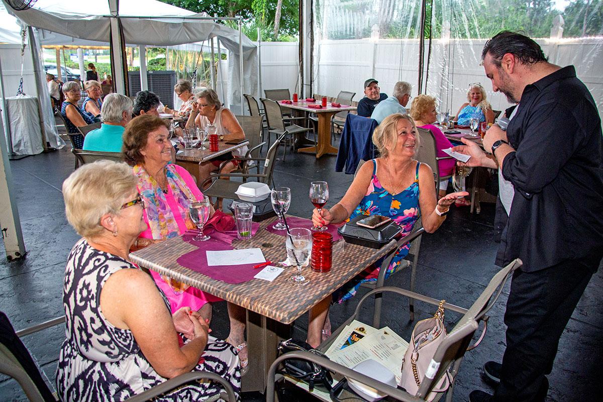 the patio of Tutto Fresco Italian Grill in PGA Village