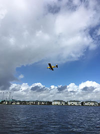 The big yellow plane flies above the Intracoastal Waterway