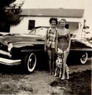 Katie, left, in front of the 1948 Mercury convertible