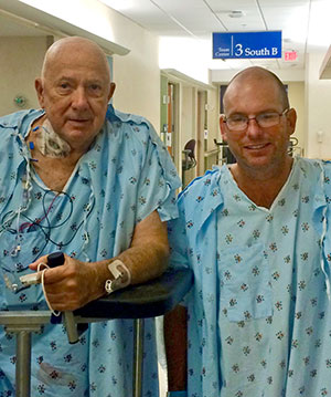 Bill Sedleckis, left, and Joe Kern walk the halls of the Mayo Clinic in Jacksonville