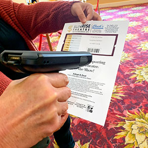 A scanner reads the code on a ticket