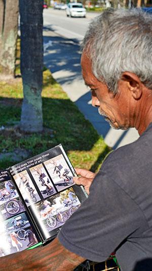 Laigo looks through his portfolio