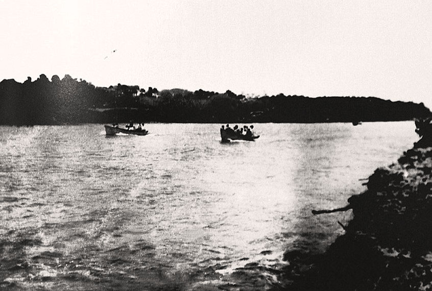 First boats passing through new inlet