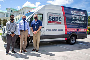 Elijah Wooten, business navigator for the city, City Manager Russ Blackburn and Tom KIndred, regional director of the Florida SBDC at IRSC